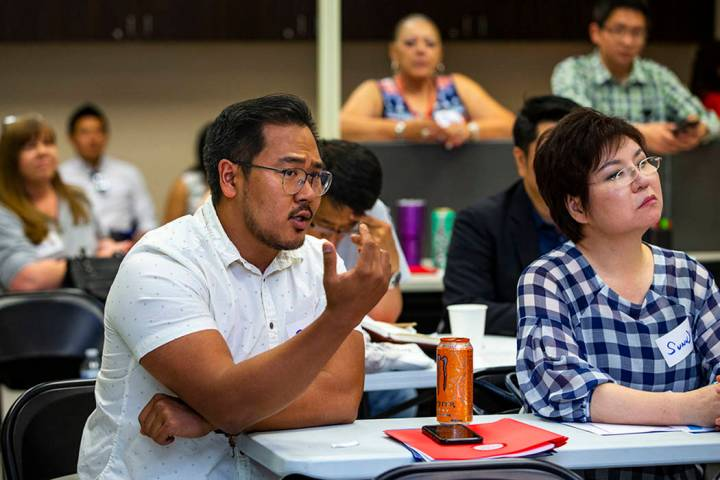 Attendee Phile Kim asks a question of U.S. Rep. Steven Horsford, D-Nev., speaking before volunt ...