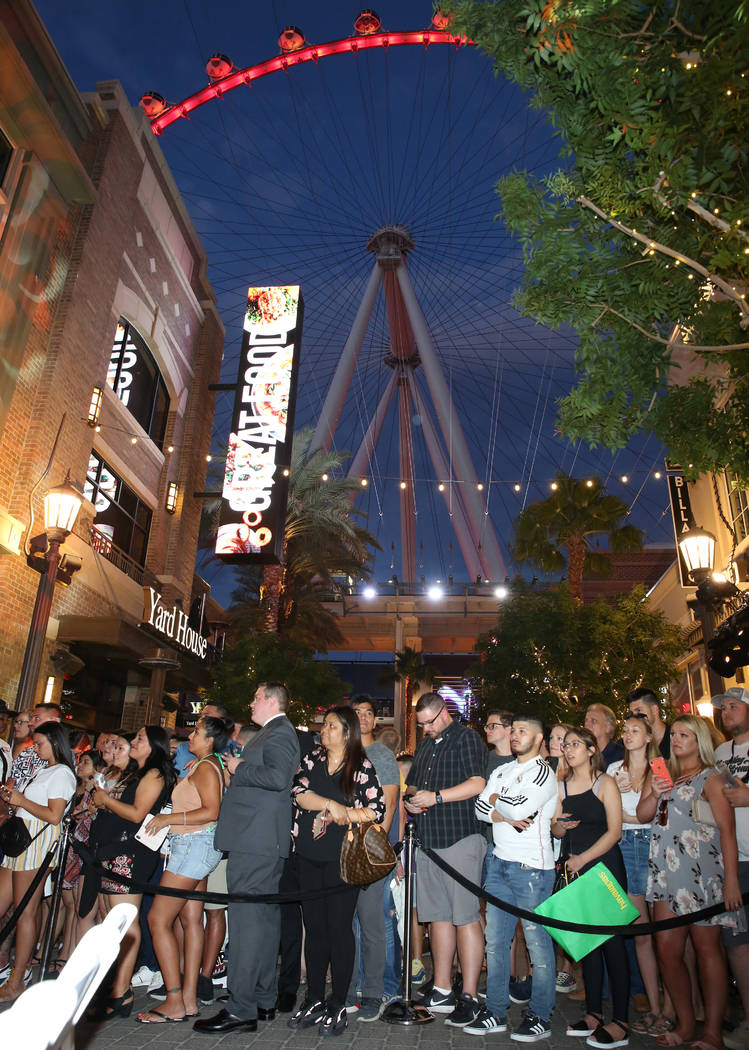 Fans watch as Emmy Award-winning TV host, Jimmy Kimmel, arrives at his comedy club during the G ...