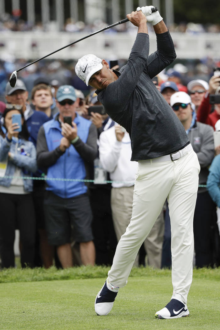 Brooks Koepka hits his tee shot on the third hole during the third round of the U.S. Open Champ ...