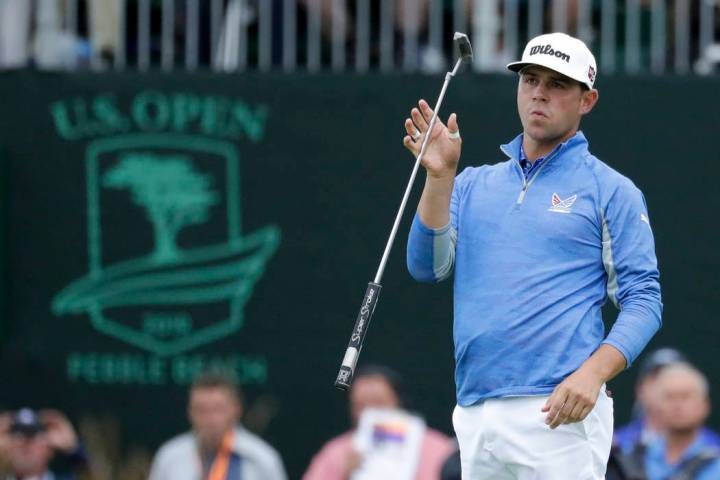 Gary Woodland reacts after missing a putt on the 18th hole during the third round of the U.S. O ...