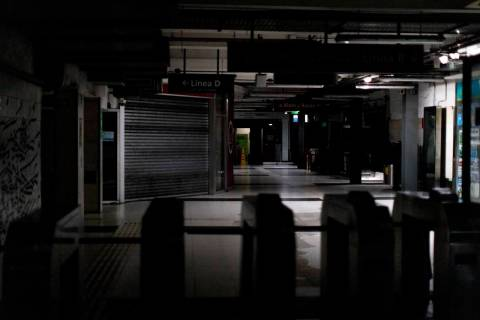 Hallways of Buenos Aires's subway are lit only by emergency lights during a blackout, in Buenos ...