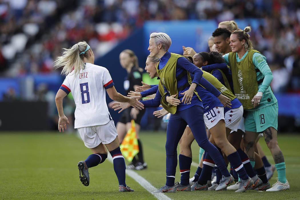 United States' Julie Ertz, left, celebrates with teammates after scoring their second goal duri ...