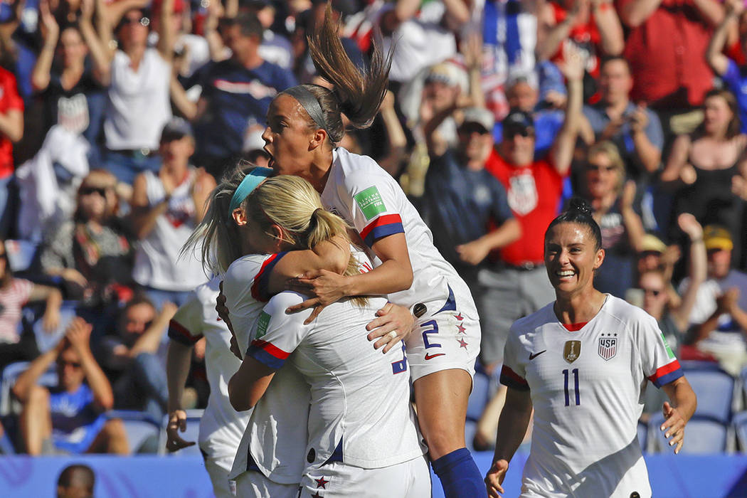 US players celebrate after teammate Julie Ertz scored their side's second goal during the Women ...