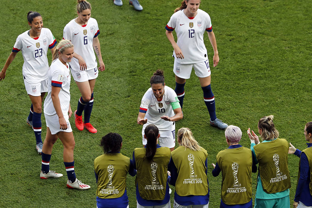 United States' Carli Lloyd, center, celebrates after scoring the opening goal during the Women' ...