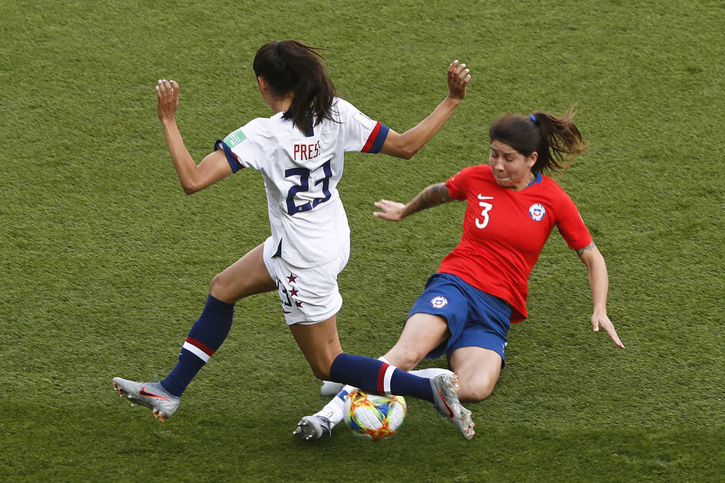 Chile's Carla Guerrero tackles United States' Christen Press, left, during the Women's World Cu ...