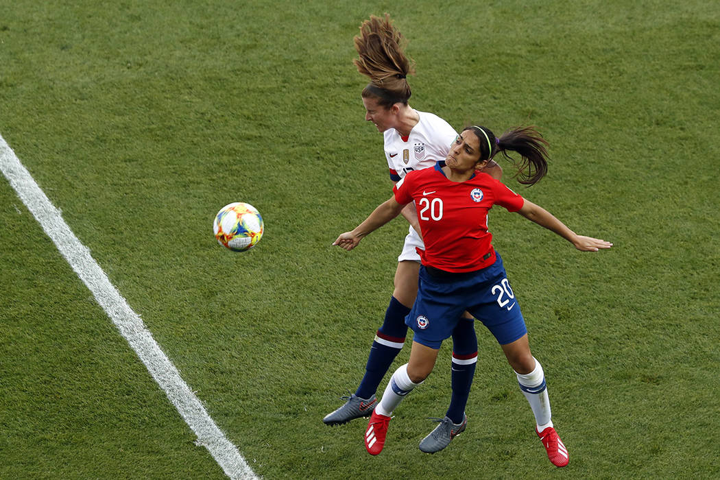 United States' Tierna Davidson jumps for the ball with Chile's Daniela Zamora, right, during th ...