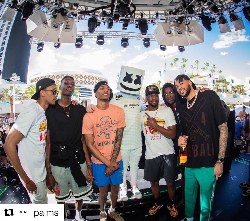 Star DJ Marshmello is shown with members of the NBA Champion Toronto Raptors at Kaos Dayclub on ...