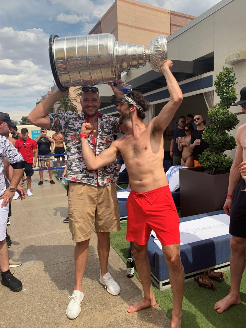 Tyson Fury and Robert Bortuzzo of the St. Louis Blues are shown with the Stanley Cup at Wet Rep ...