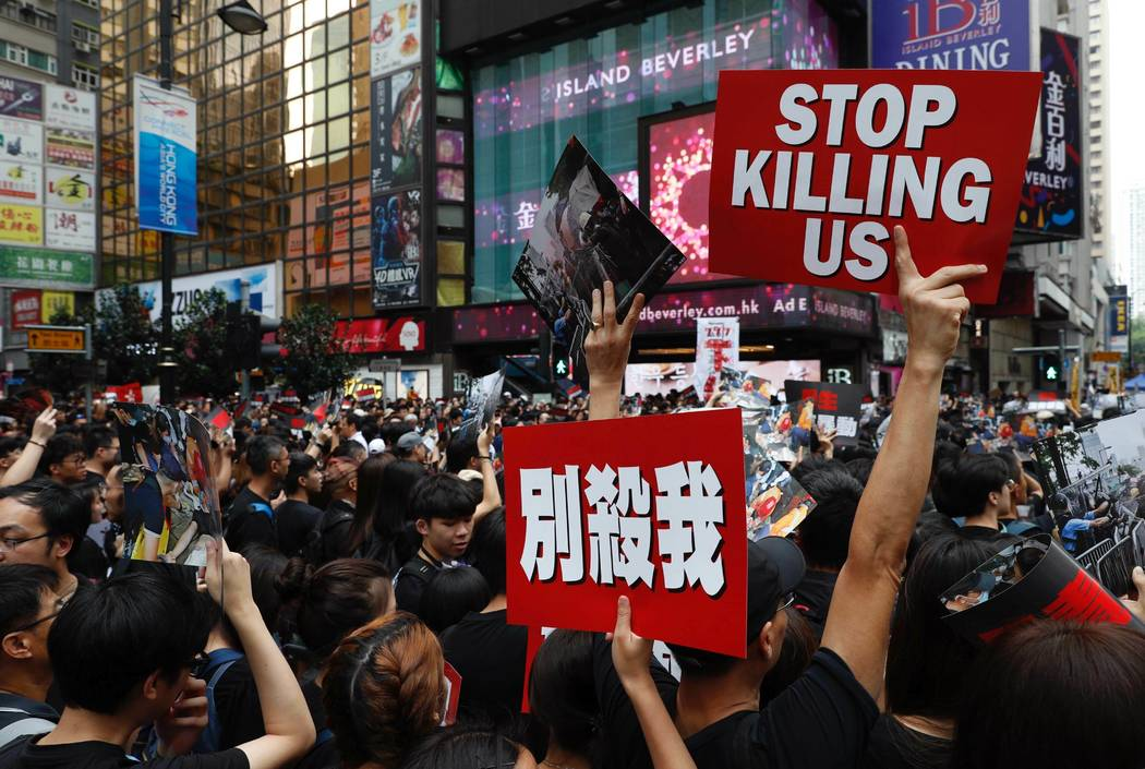 Protesters march on the streets against an extradition bill in Hong Kong on Sunday, June 16, 20 ...