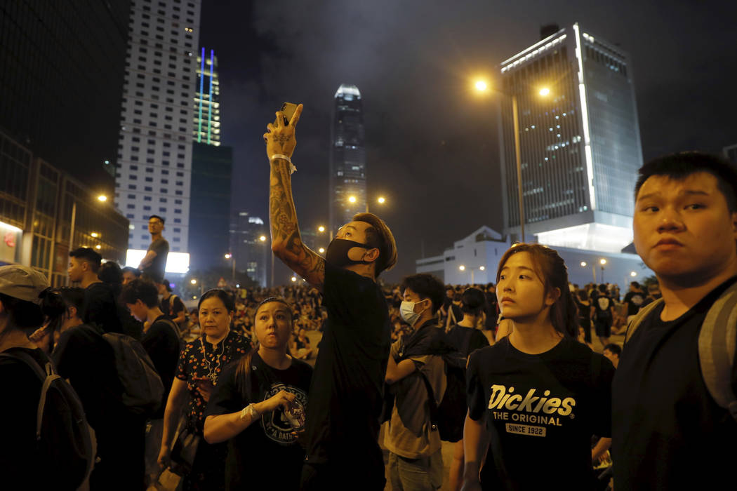 Protesters gather into the night against an unpopular extradition bill in Hong Kong on Sunday, ...