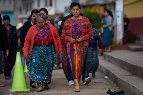 Indigenous women arrive at a polling station in Sumpango, Guatemala, Sunday, June 16, 2019. Gua ...