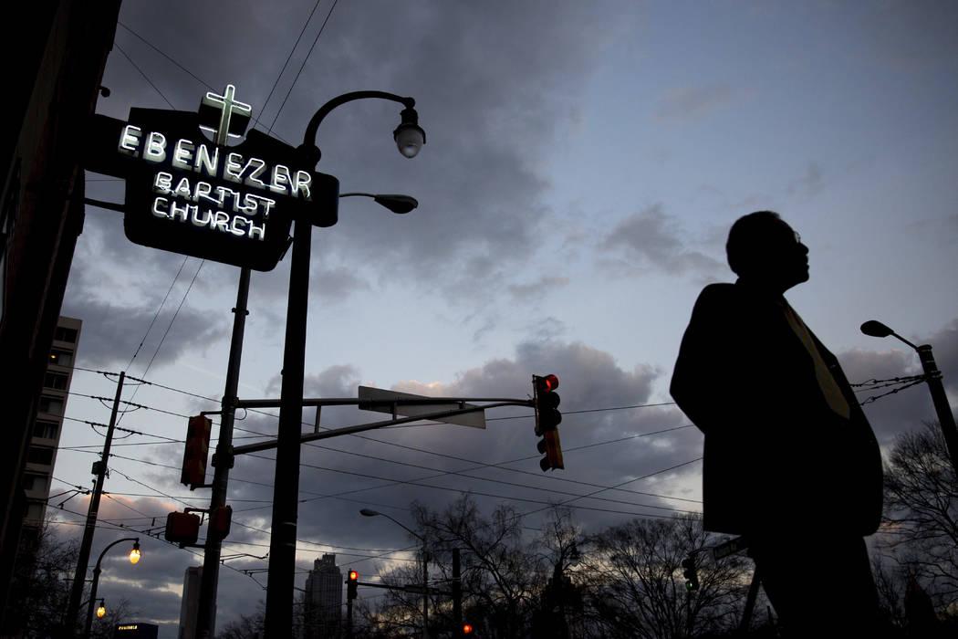 A man walks past Ebenezer Baptist Church, early Monday, Jan. 16, 2017, in Atlanta, before the R ...