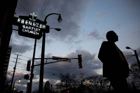 A man walks past Ebenezer Baptist Church, early Monday, Jan. 16, 2017, in Atlanta, before the R ...