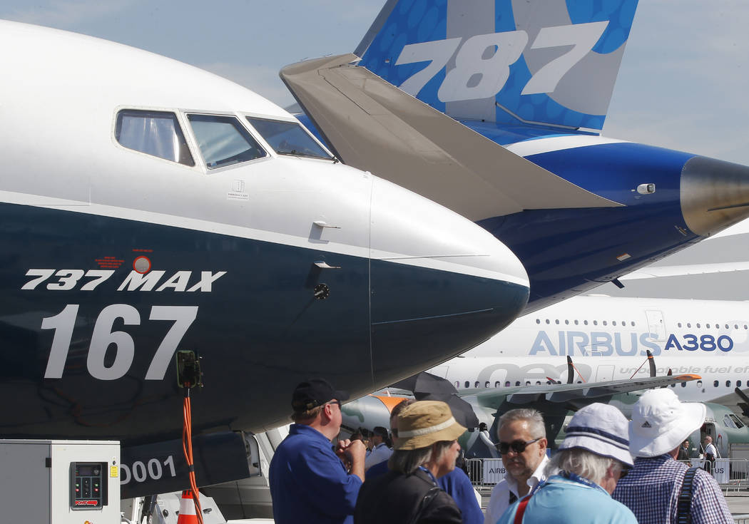 FILE - In this June 20, 2017, file photo Boeing planes displayed at Paris Air Show, in Le Bourg ...