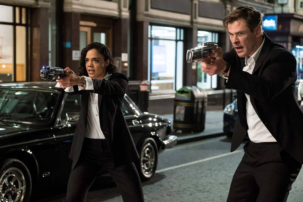 This image released by Sony Pictures shows Tessa Thompson and Chris Hemsworth in a scene from C ...