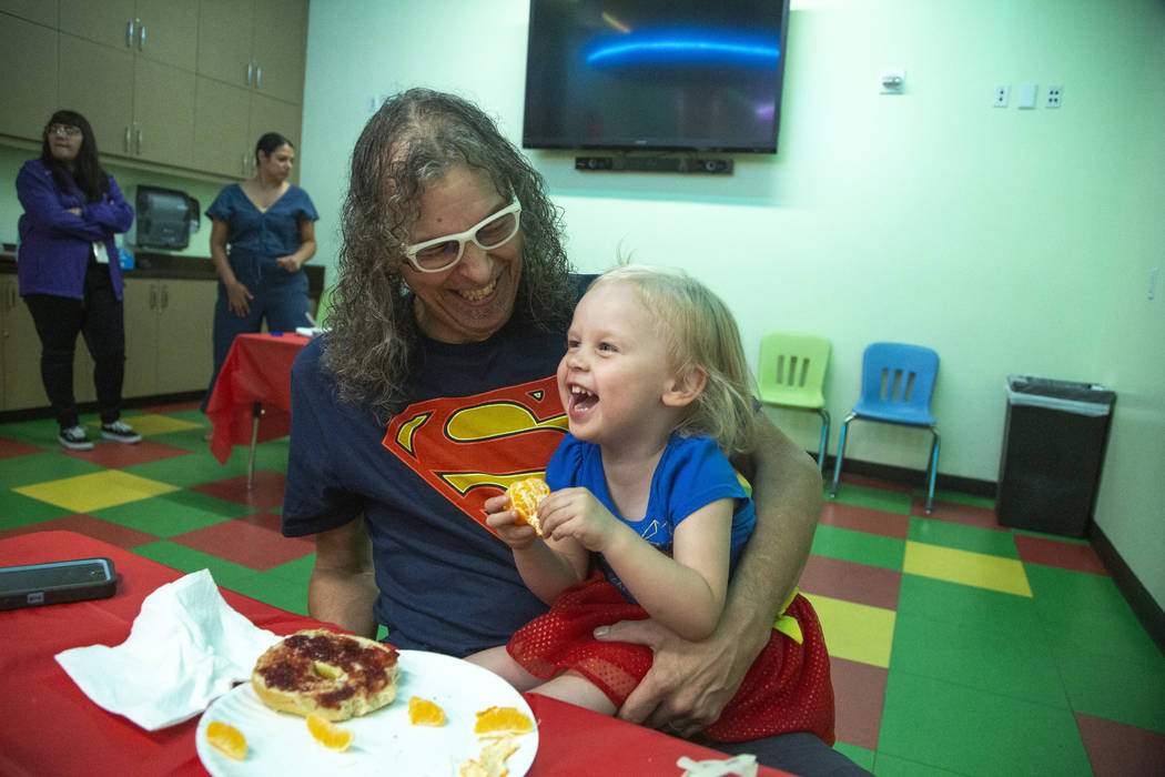 Chris Guzman, left, laughs with his daughter, Jazz Lapare-Guzman, 3, during an event to celebra ...