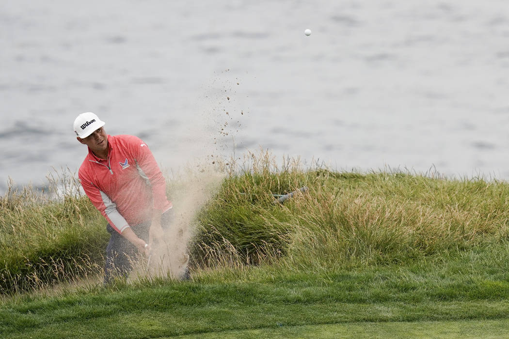 Gary Woodland hits out of the bunker on the seventh hole during the final round of the U.S. Ope ...