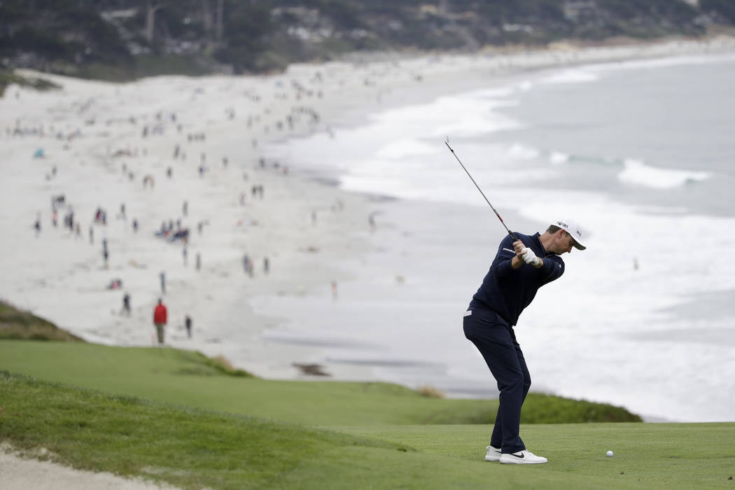 Justin Rose, of England, hits from the fairway on the ninth hole during the final round of the ...