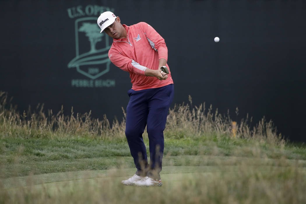 Gary Woodland chips off the 17th green during the final round of the U.S. Open Championship gol ...