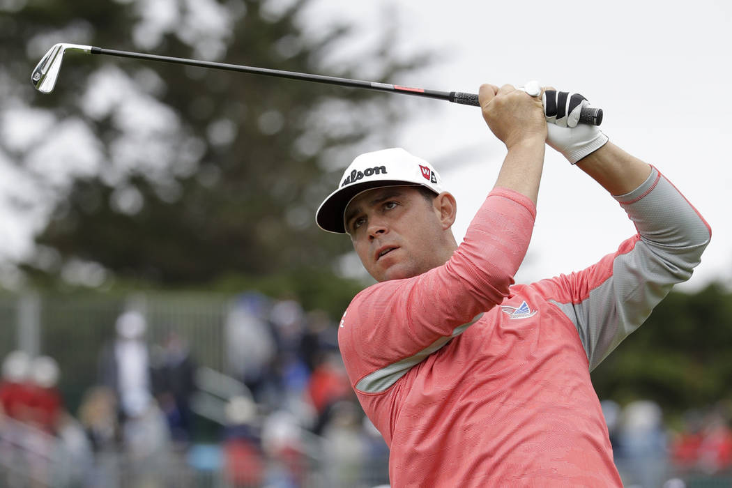 Gary Woodland watches his tee shot on the fourth hole during the final round of the U.S. Open C ...