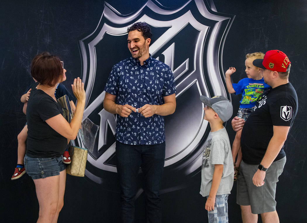 Amber Perez, left, holds her son Cassius, 4, while chatting with Golden Knights player Mark Sto ...