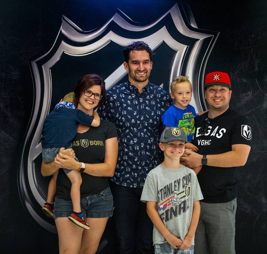 Golden Knights player Mark Stone stands with the Perez family of Las Vegas during a fan photo o ...