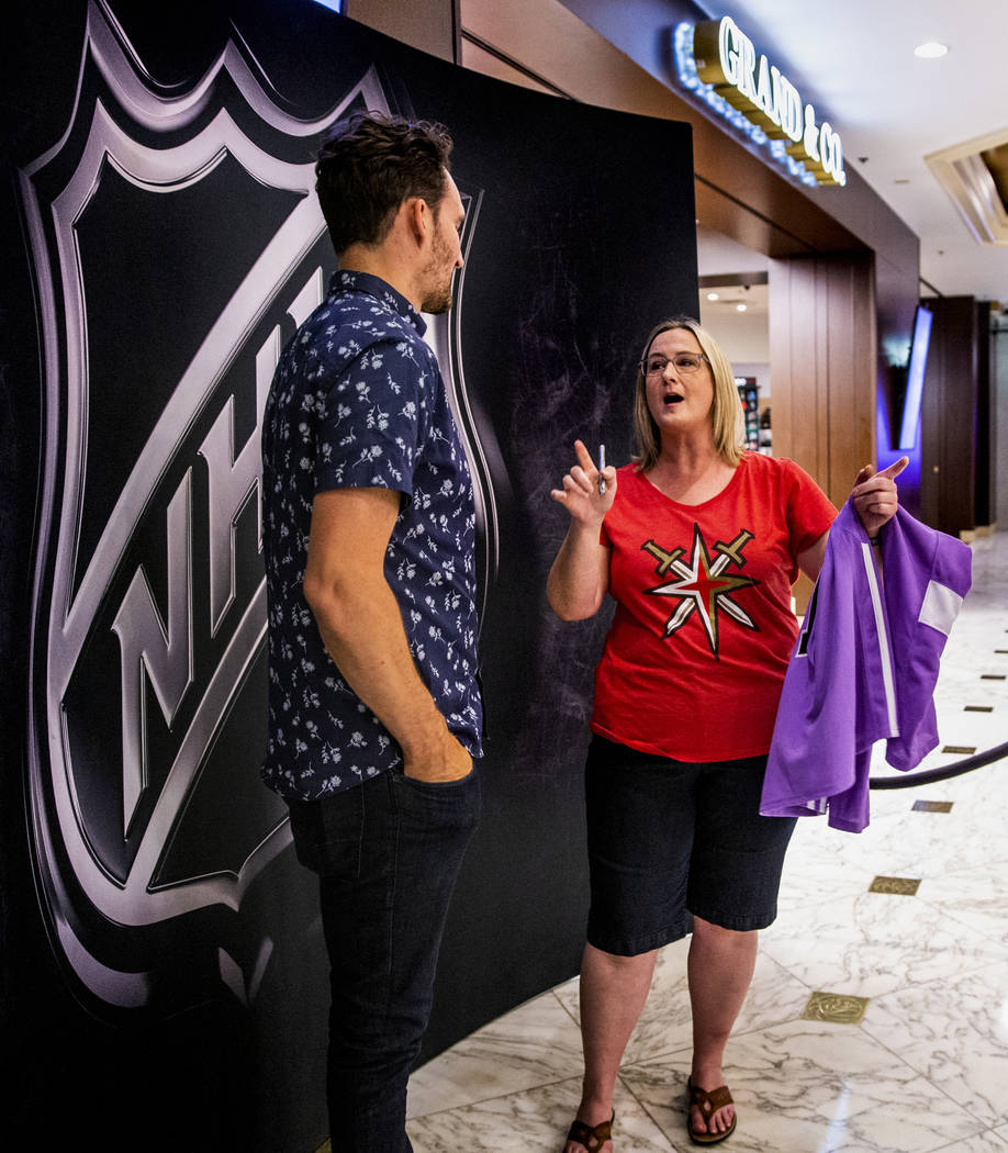 Golden Knights player Mark Stone is told a story of their past meeting by Kristie McWhorter of ...