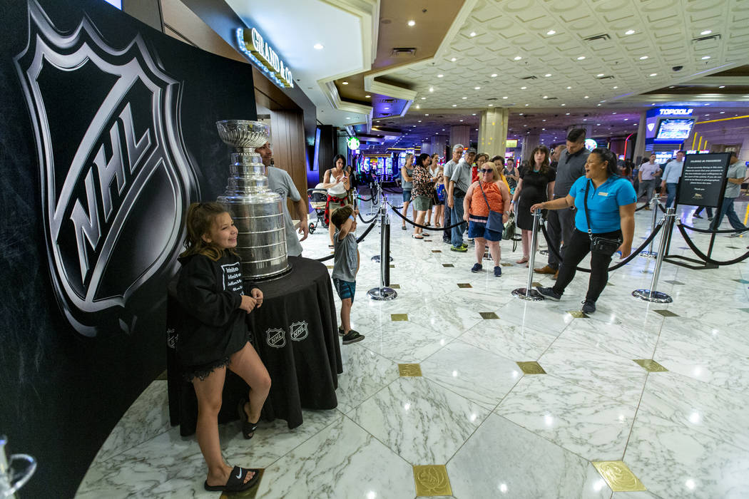 Fans wait in line to strike a pose with the Stanley Cup, the most recognizable and revered trop ...