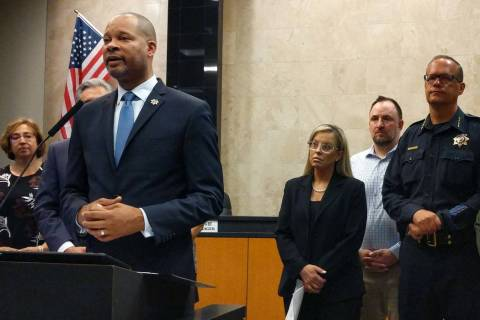 Nevada Attorney General Aaron Ford, left, speaking during a press conference at Reno City Hall ...