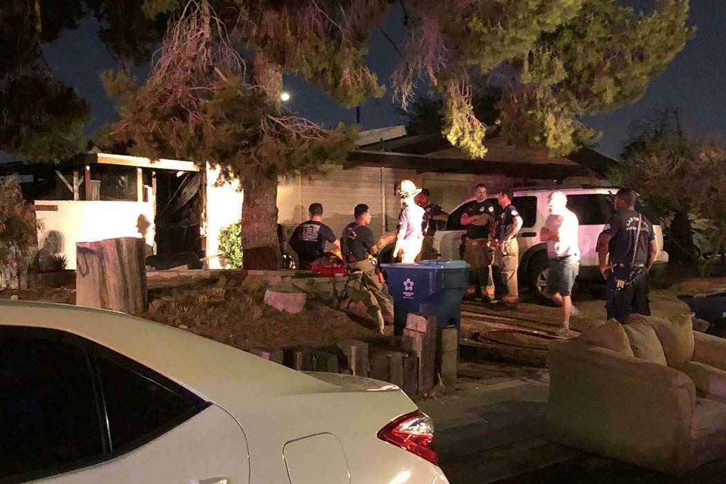 Two people were treated at the scene for smoke inhalation in a fire at two two east Las Vegas V ...