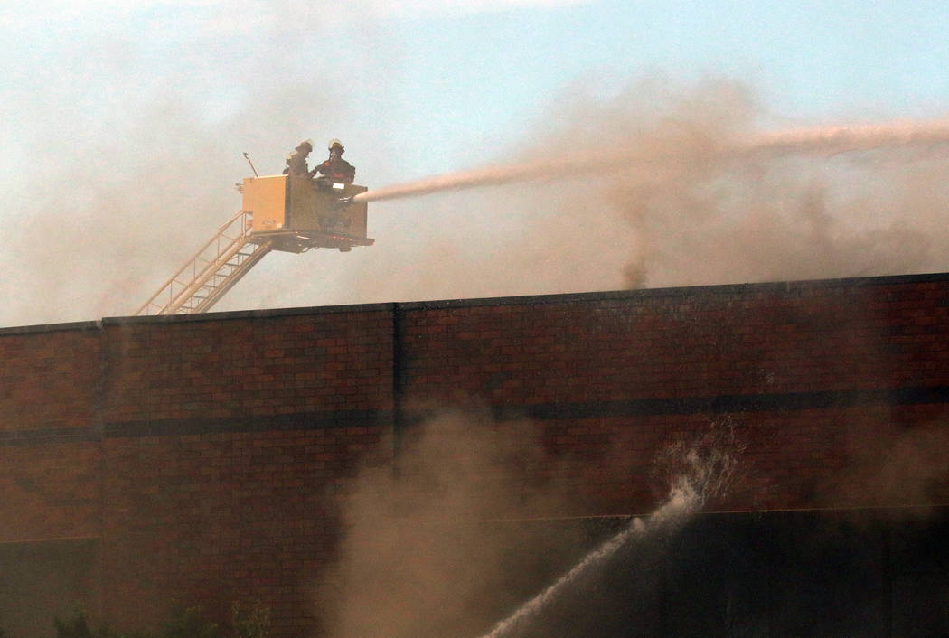 Clark County and Las Vegas fire crews battle a blaze at The Park at 3900 at 3900 Paradise Road, ...