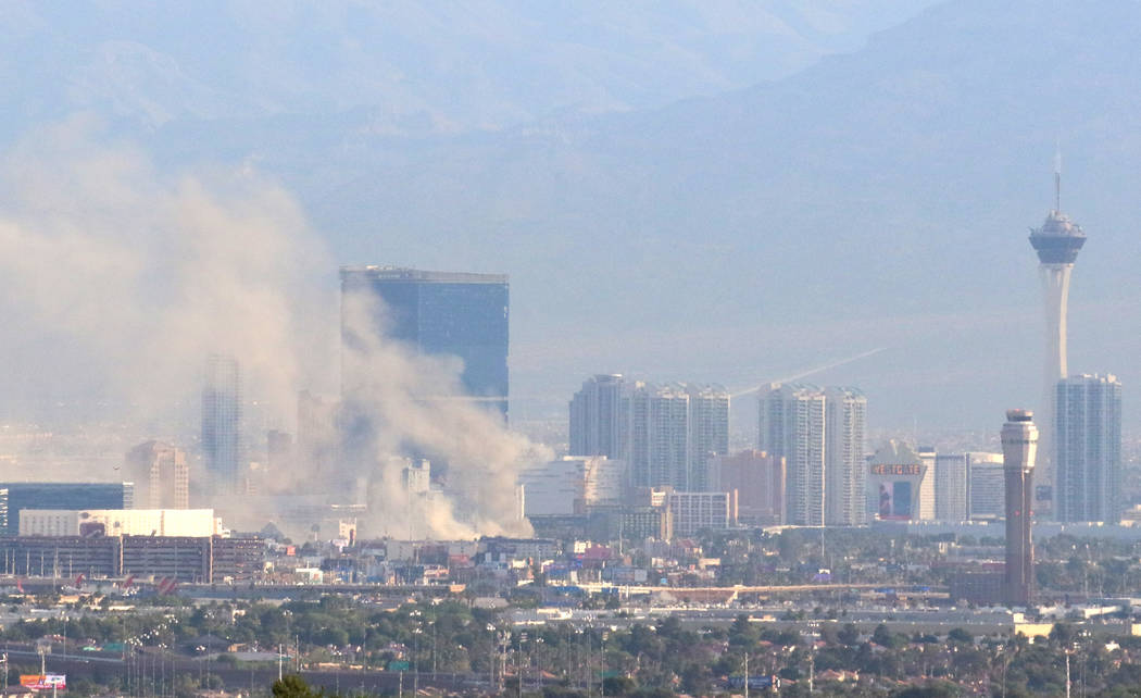 Heavy smoke is seen as Clark County and Las Vegas fire crews battle a blaze at The Park at 3900 ...