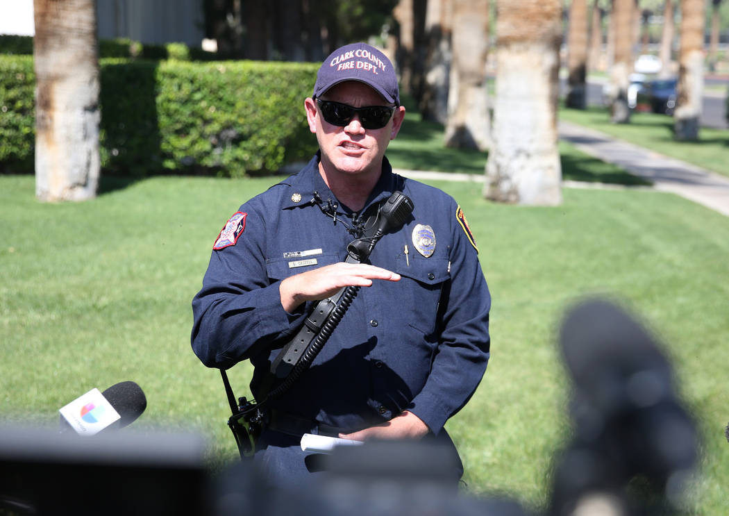 Clark County Fire Chief Greg Cassell, center, addresses the media during a press conference at ...