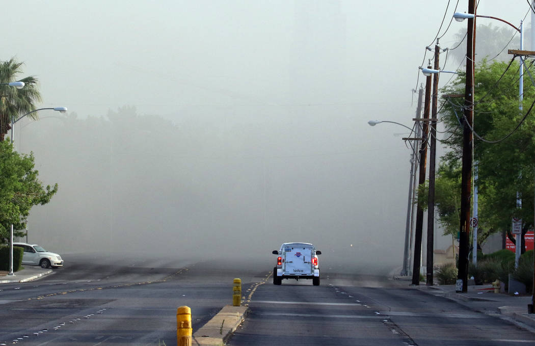 Smoke filled southbound Paradise Road was closed between East Flamingo Road and Twain as Clark ...