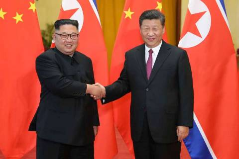 In a June 19, 2018, file photo released by China's Xinhua News Agency, Chinese President Xi Jin ...