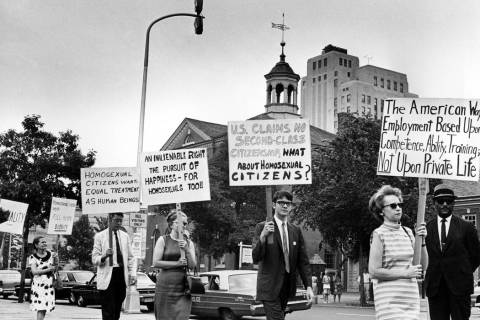 In a July 4, 1967, file photo Kay Tobin Lahusen, right, and other demonstrators carry signs cal ...