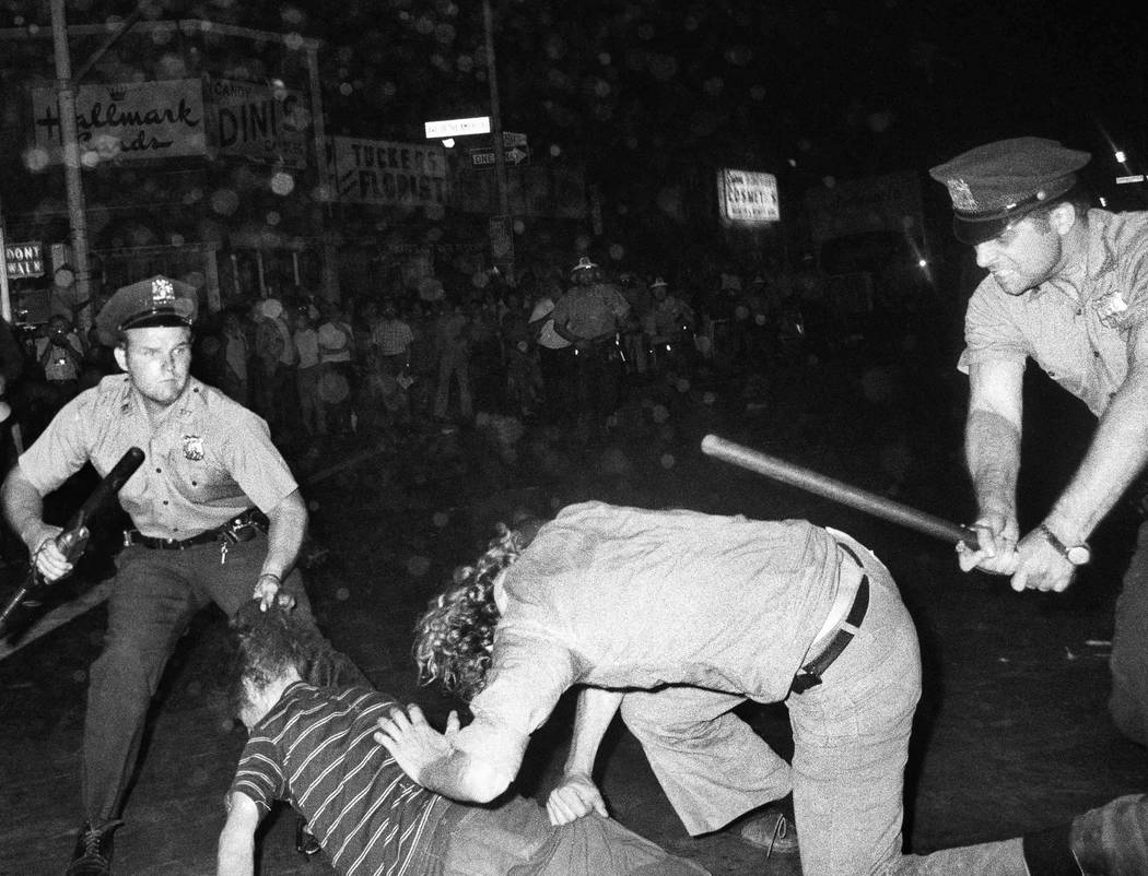 FILE - In this Aug. 31, 1970 file photo, an NYPD officer grabs a youth by the hair as another o ...