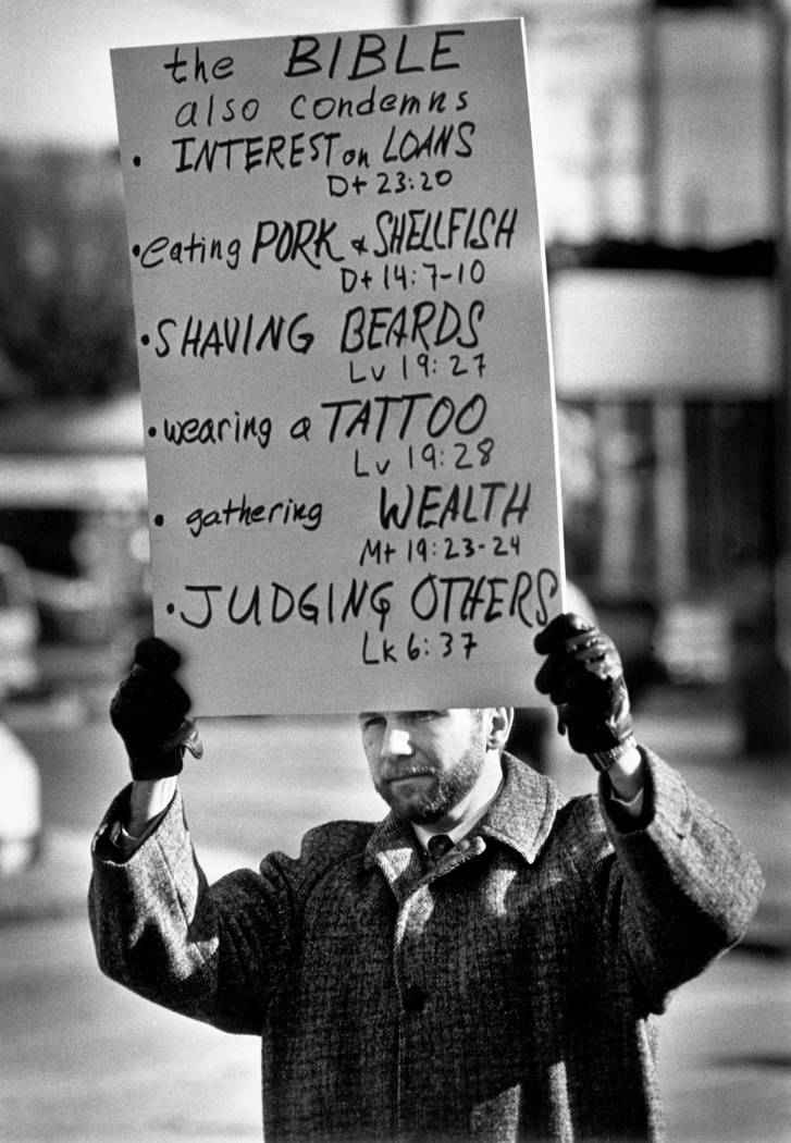 FILE - In this Dec. 9, 1992 file photo, gay-rights activist Thomas L. Long carries a list of ad ...