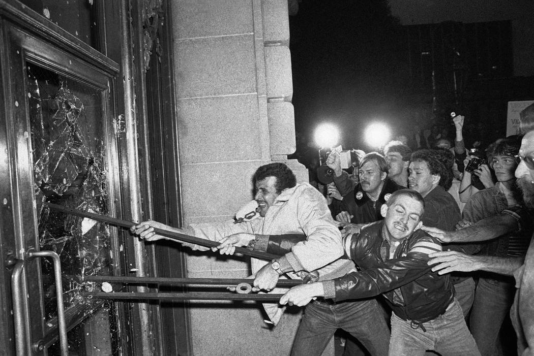 FILE - In this May 22, 1979 file photo, demonstrators smash glass out of the front doors of the ...