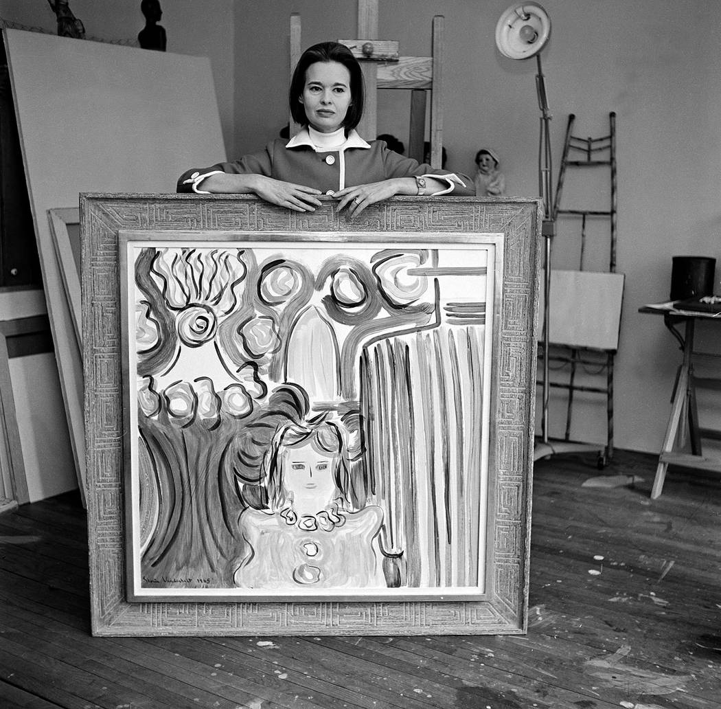 Gloria Vanderbilt Cooper poses with one of her paintings, at her private studio in New York Cit ...