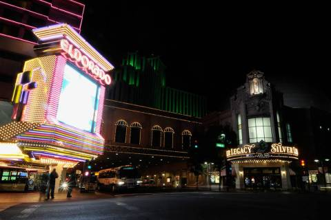 Pedestrians wait to cross the street from the Eldorado Hotel and Casino to the Silver Legacy Re ...
