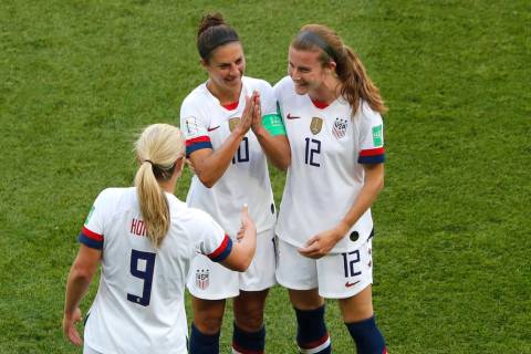 United States' Carli Lloyd , center, celebrates with Lindsey Horan and Tierna Davidson, right, ...
