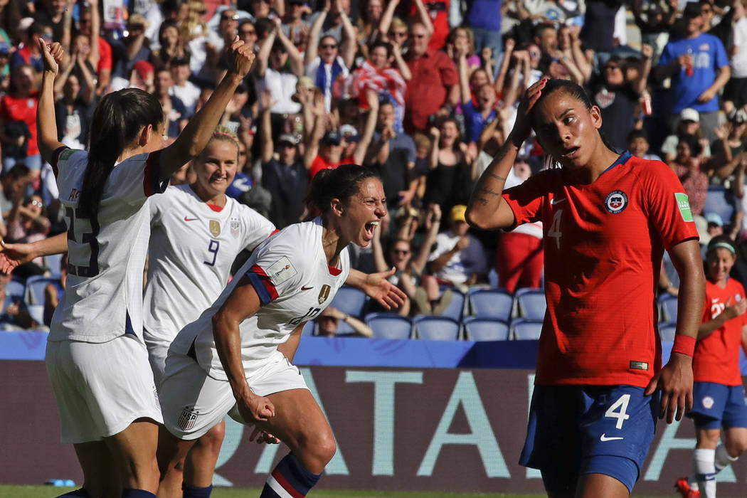 United States' Carli Lloyd, center, celebrates with teammates after scoring their side's third ...