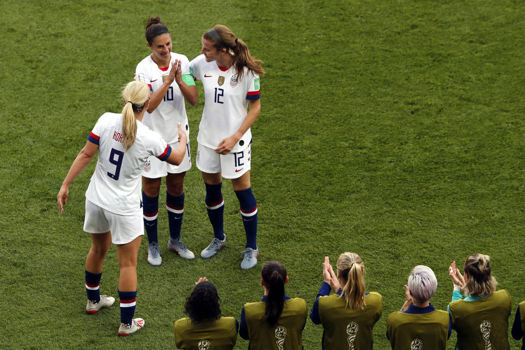 United States' Carli Lloyd, top center, celebrates with Lindsey Horan and Tierna Davidson, righ ...