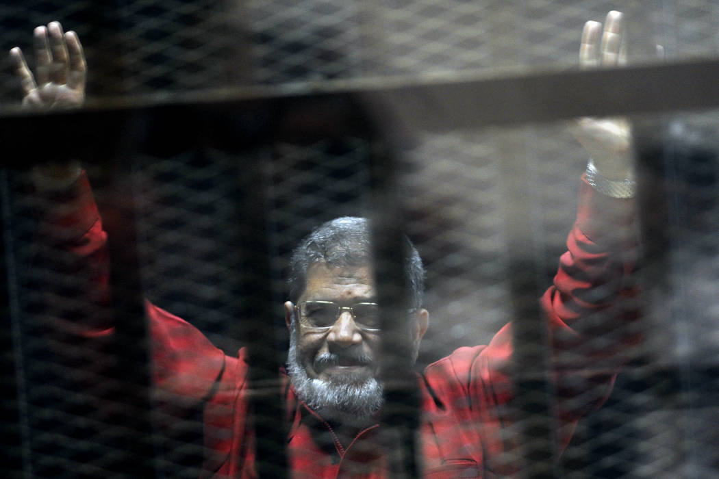 Former Egyptian President Mohammed Morsi, wearing a red jumpsuit that designates he has been se ...