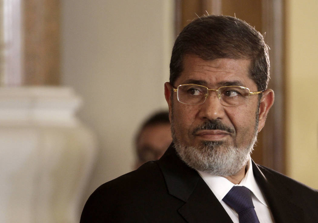 The-Egyptian President Mohammed Morsi holds a news conference at the Presidential palace in Cai ...