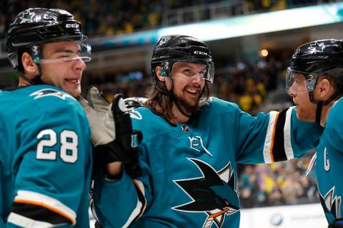FILE - In this Feb. 16, 2019, file photo, San Jose Sharks' Erik Karlsson, center, celebrates wi ...