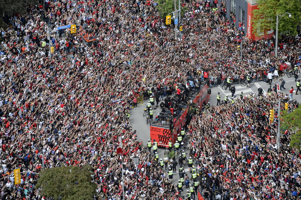 Fans cheer during the Toronto Raptors NBA basketball championship victory parade in Toronto, Mo ...