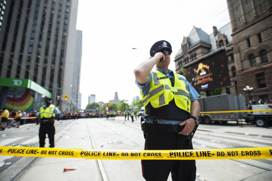 Toronto Police secure the scene after a shots were fired during the Toronto Raptors NBA basketb ...