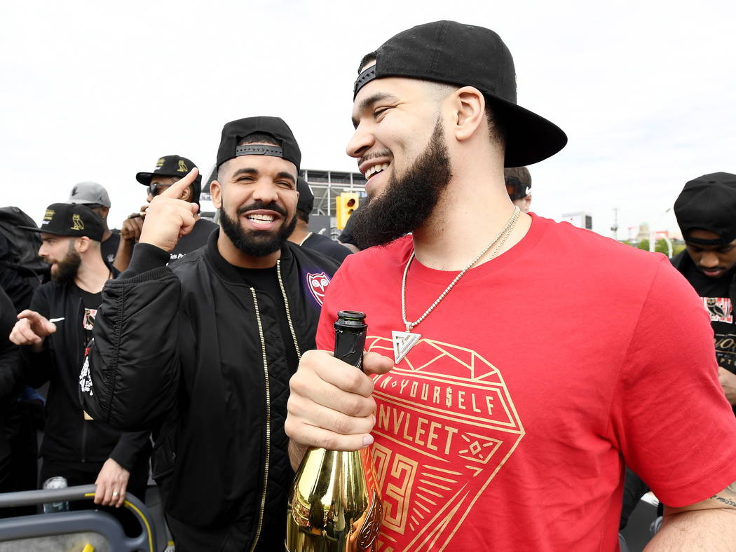 Toronto Raptors guard Fred VanVleet, right, celebrates with performing artist Drake during the ...